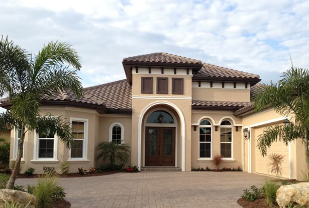 Spanish-style house in Florida with windows of varying styles.
