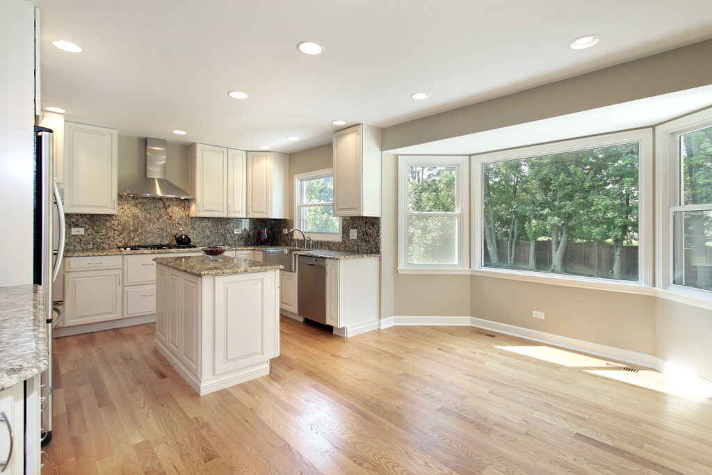 Kitchen in remodeled home with large picture window